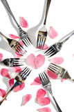 Gold and silver forks surrounding heart shape Royalty Free Stock Image