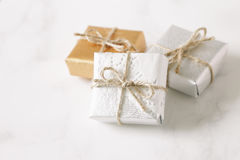 Gold and silver gift boxes on table