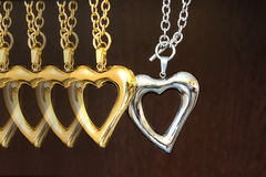 Gold and silver heart Stock Image