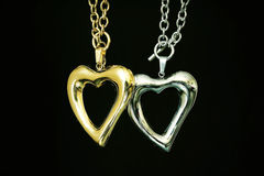 Gold and silver heart Stock Photography