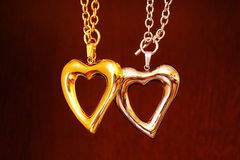 Gold and silver heart. Necklace stainless surgical steel royalty free stock images
