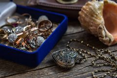 Gold and silver jewelry on wood table Stock Image