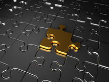 Gold and silver jigsaw puzzle pieces. The golden jigsaw puzzle piece completes the whole puzzle Stock Photo