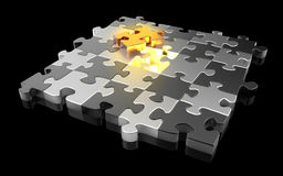 Gold and silver jigsaw puzzle pieces. Black background Royalty Free Stock Photo