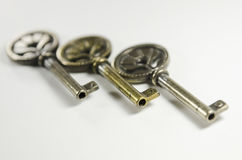 Gold and silver keys Royalty Free Stock Photos