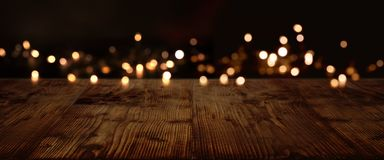 Gold and silver lights on dark wood stock image
