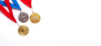 Gold and silver medals with ribbon on white background stock photo