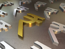 Gold and silver metal floor of rupee signs stock photos