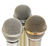 Gold and silver microphones. On the white background Stock Photography