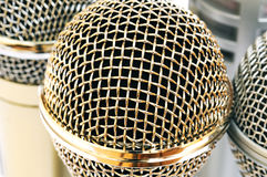 Gold and silver microphones. On white background Royalty Free Stock Photo