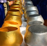 Gold and Silver monk alms bowls Thailand.  Stock Photos