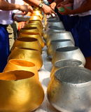 Gold and Silver monk alms bowls Thailand.  Stock Image