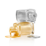 Gold and silver nail polish spilled Royalty Free Stock Images