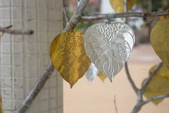 Gold and silver PHO or Bhodi leaf made from Aluminium for decoration royalty free stock photo