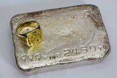 Gold and Silver - Precious Metals. Large gold nugget ring and silver bullion bar (ingot) - Precious Metals Royalty Free Stock Photos