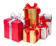 Gold, silver and red gift boxes on white background Royalty Free Stock Photography