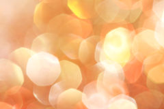 Gold, silver, red, white, orange abstract bokeh lights, defocused background Royalty Free Stock Images