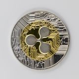 A Gold and Silver Ripple XRP Token.  royalty free stock photo