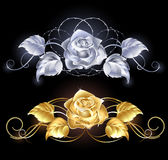 Gold and silver rose. Two shiny, gold rose, gold and silver on a black background