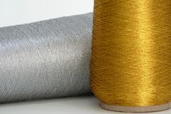 Gold and silver sewing thread - close-up royalty free stock photos