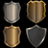 Gold and silver shields set on black background. Royalty Free Stock Photo