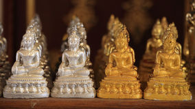 Gold and silver small Buddha statues Royalty Free Stock Photo