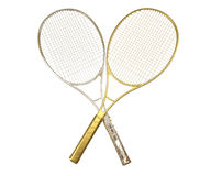 Gold and silver tennis rackquets crossed. Royalty Free Stock Photography