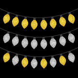 Gold and silver textured Christmas lights set. Isolated realistic luminous garland design elements. Glowing lights for Xmas Holiday greeting card. Garlands Stock Photo