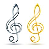 Gold and silver treble clef on white background Stock Image