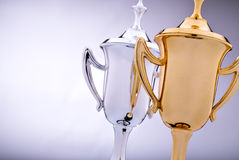 Gold and silver trophies waiting to be awarded Royalty Free Stock Image