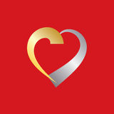 Gold and silver Valentine Heart. Heart of gold and silver as a gift for Valentine Stock Photo