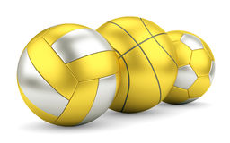 Gold and silver volleyball, basketball and soccerball in row Royalty Free Stock Photos