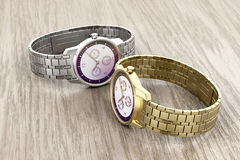 Gold and silver watches Royalty Free Stock Image