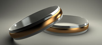 Gold and silver wedding rings 3d. On a gray background Stock Image
