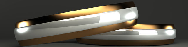 Gold and silver wedding rings 3d. On a gray background Royalty Free Stock Photography