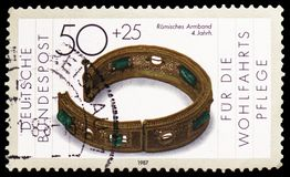 Gold- and silver, Welfare: Gold and silver forging serie, circa 1987. MOSCOW, RUSSIA - FEBRUARY 22, 2019: A stamp printed in Germany, Federal Republic shows Gold royalty free stock photography