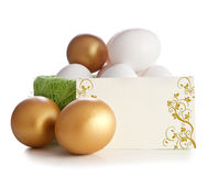 Gold and simple eggs Stock Photo