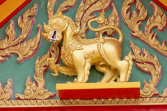 Gold Singha in the temple Royalty Free Stock Photos