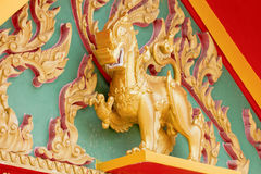 Gold Singha in the temple. Thailand Royalty Free Stock Photo