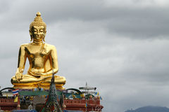 Gold sitted Buddha. A big Buddha at north Thailand near Laos and Burma Stock Image