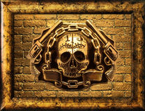 Gold skull and gun on the brick wall background. Skull guns on a background of golden brick wall Stock Photos