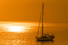Gold sky background with yacht Royalty Free Stock Photos