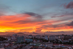 The gold sky with the gold cloud. Over town Royalty Free Stock Photo
