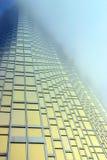 Gold Skyscraper in the fog Stock Photo