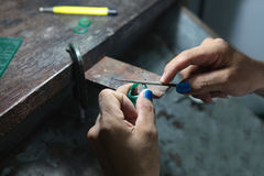 Gold smith making a ring' s wax mold, jewelry making Royalty Free Stock Images