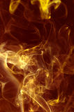 Gold smoke, ink or flame. Close-up of smoke in the golden light Royalty Free Stock Images