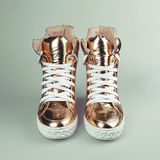 Gold sneakers Royalty Free Stock Photos