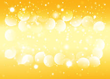 Gold snow bokeh background. Royalty Free Stock Images
