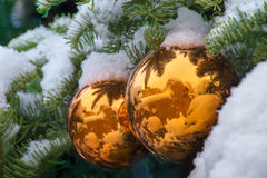 Gold Snow Covered Christmas Tree Ornaments Reflect Santa Fe Adobe Buildings royalty free stock photography