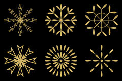 Gold snow flakes set. Sign isolated on black background Stock Images